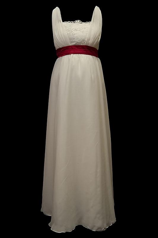Długa suknia ślubna ciążowa greczynka z koronkowym gorsetem i dekoltem w szpic.