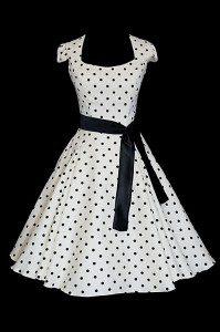 Krótka sukienka koktajlowa w grochy,z dekoltem w łódkę i czarne paskiem.
